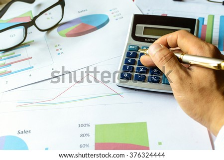businessman working on Desk office business financial accounting calculate, Graph analysis - stock photo