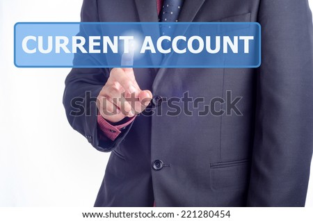 Businessman working on digital virtual screen press on button Current Account - stock photo