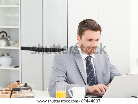 Businessman working on his laptop at home