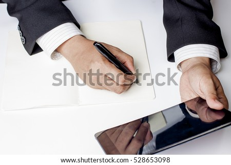 Businessman working on his tablet.