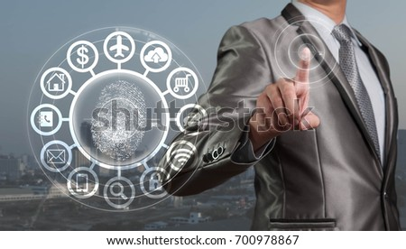 Businessman working on iot : internet of things with finger print recognition technology accessibility