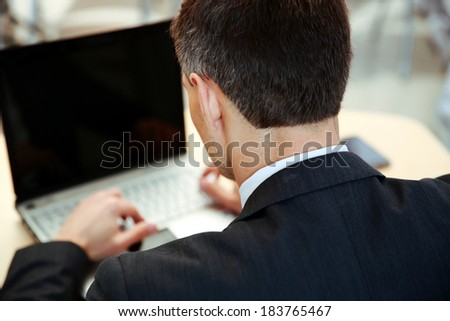 Businessman working on laptop. View from above