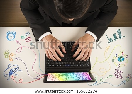 Businessman working on notebook with different task - stock photo