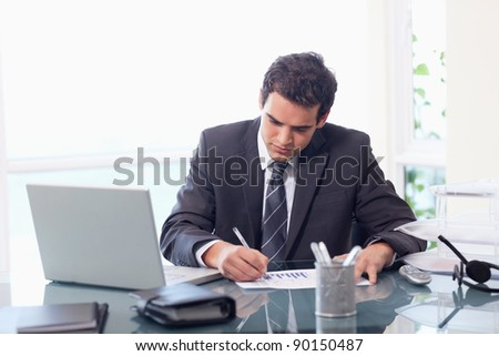 Businessman working on statistics in his office