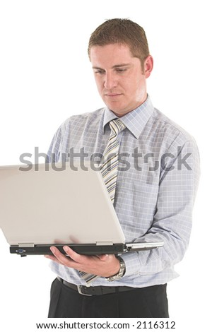 Businessman working on the laptop over white backdrop