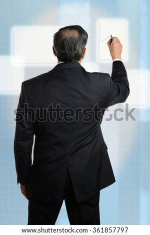 Businessman working on virtual screen with electronic pen