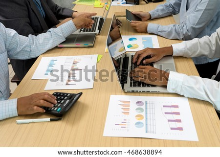 businessman working plan the business and analysis many chart graph for executive meeting consulting , vintage tone sunlight