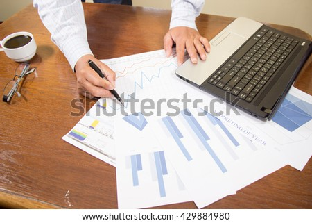 businessman working use laptop in office for discussing documents and ideas , with soft focus, vintage tone