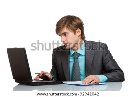 businessman working using laptop computer, handsome young businessman sitting at the desk wear elegant suit, isolated over white background. - stock photo