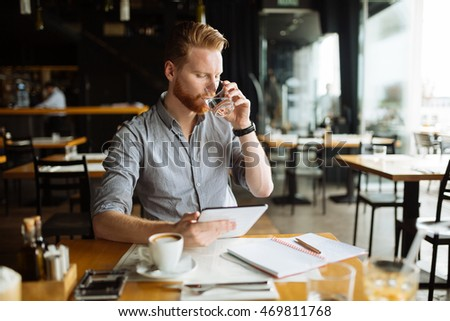 Businessman working while taking a break, no time to waste