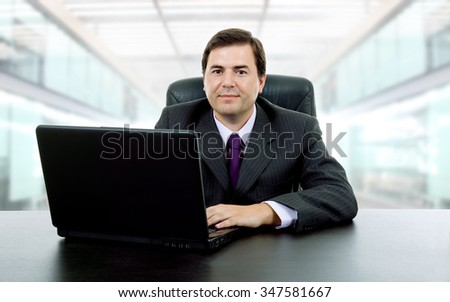 businessman working with a laptop, at the office