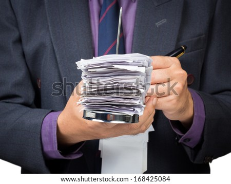 Businessman working with bills in paper nail - stock photo