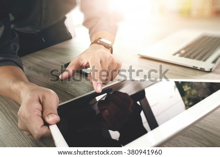 businessman working with blank screen digital tablet computer and smart phone and laptop computer on wooden desk as concept - stock photo