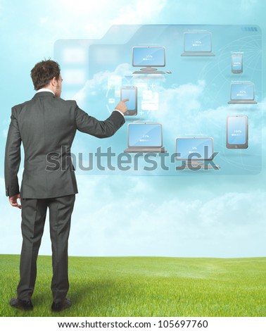 Businessman working with cloud compute technology - stock photo