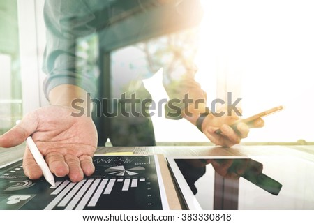 businessman working with digital tablet computer and smart phone on wooden desk as concept - stock photo