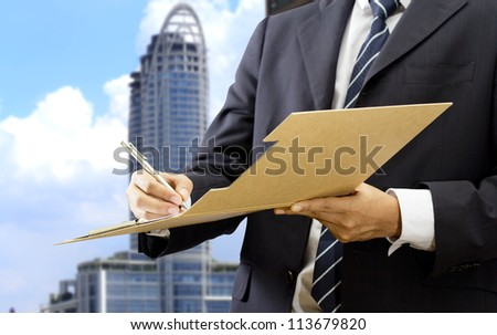 Businessman working with document sign up contract, modern office the background - stock photo