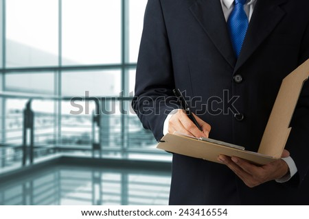 Businessman working with documents sign up contract at the office  - stock photo