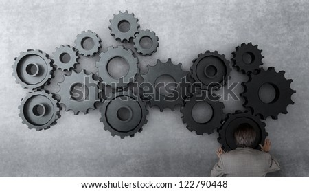 businessman working with gear to success as concept - stock photo