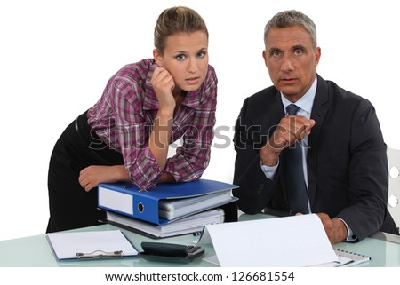 Businessman working with his assistant