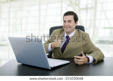 businessman working with is laptop at the office - stock photo