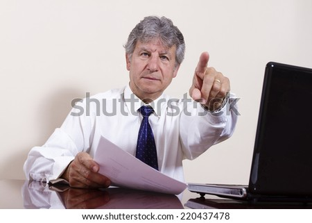 Businessman working with laptop in a interior office. - stock photo