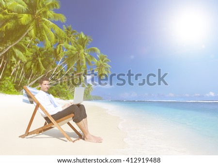 Businessman Working with Laptop on Beach Concept