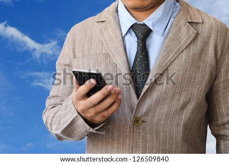 Businessman working with mobile phone - stock photo