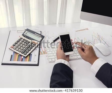 businessman working with modern devices, computer and mobile phone on office desk - stock photo