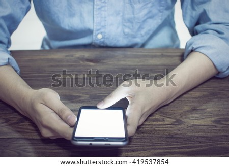 Businessman Working With Modern Devices, Digital And Mobile Phone(Vintage) - stock photo