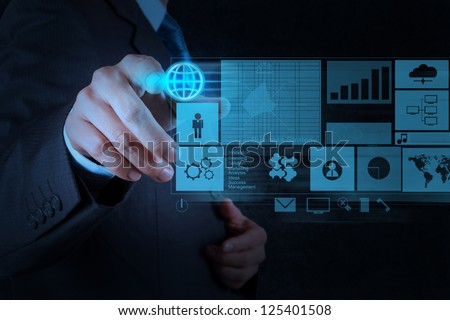 businessman working with new modern computer pushing social network structure - stock photo