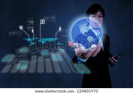 businessman working with new modern computer show the earth social network structure as concept