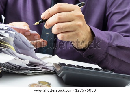Businessman working with receipts - stock photo