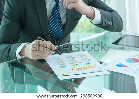 businessman working with report - stock photo