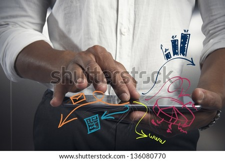 Businessman working with tablet with business task - stock photo