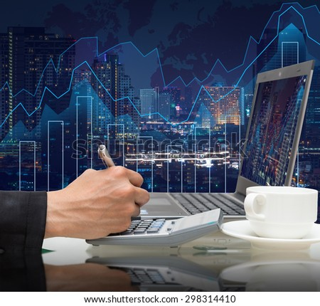 Businessman working with the laptop on Trading graph on the cityscape at night and world map background,Business financial concept - stock photo