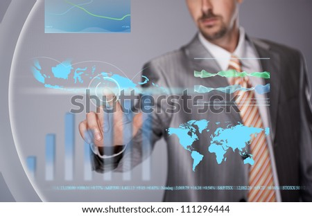 Businessman working with touch screen - stock photo