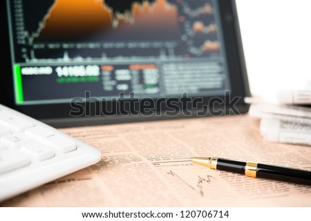 Businessman workplace with digital tablet - stock photo