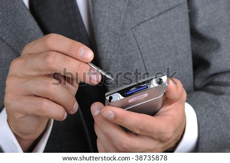 businessman works as a portable computer, hands a closeup