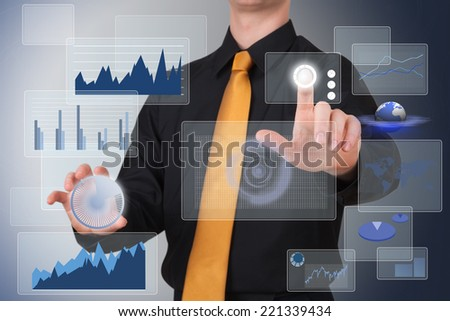 Businessman works with huge tech screen - stock photo