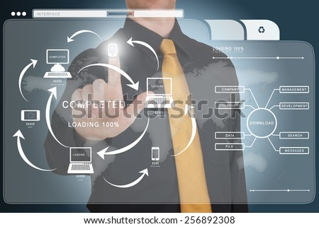 Businessman works with huge touch screen. Connectivity between different devices concept - stock photo