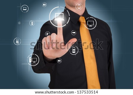 Businessman works with modern touch screen - stock photo