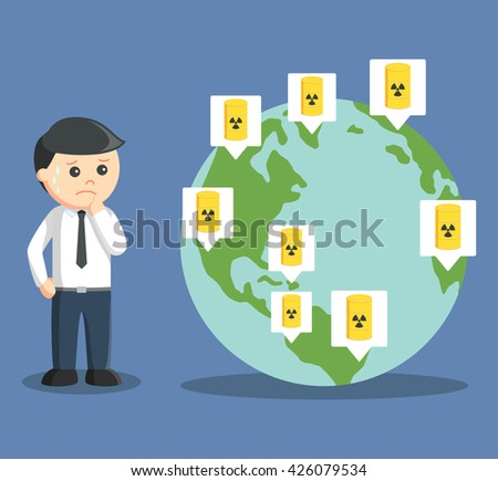 Businessman worried when seeing globe full of nuclear waste - stock photo