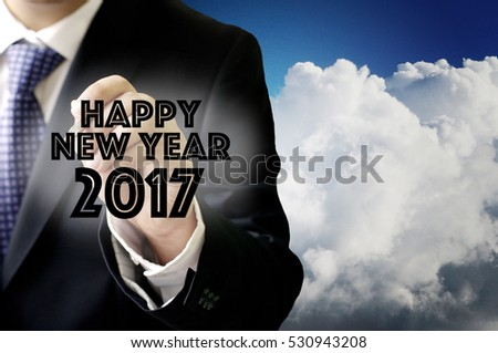 Businessman write a greeting word, Happy new year