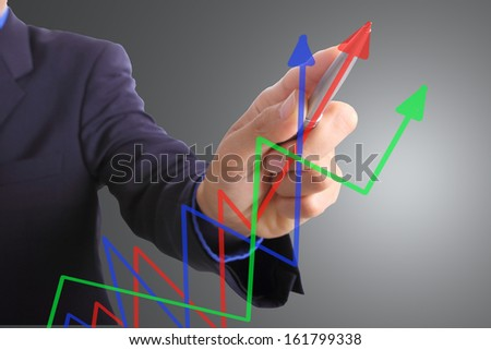Businessman write graph business for explain something