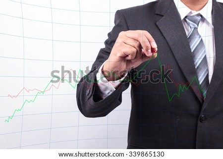Businessman write growing graph for check - stock photo