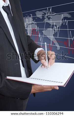 Businessman write on notebook with finance graph. - stock photo