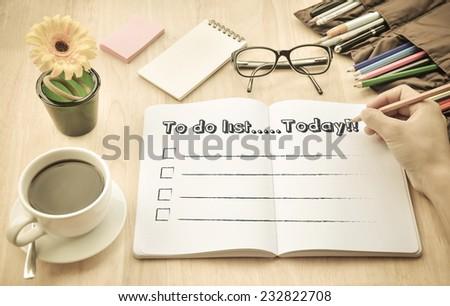 Businessman write schedule in coffee shop. - stock photo