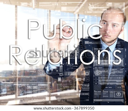 businessman writes on board text: Public relations - with sunset over the city in the background, the visible sun's rays in a picture are symbolizing the positive attitude - stock photo