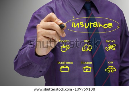 Businessman writing an insurance concept - stock photo