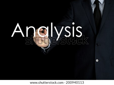 businessman writing analysis on black background